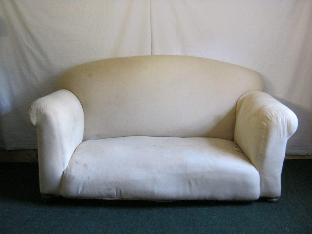 Antique, traditionally upholstered 2 Seater sofa.