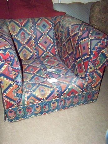 Liberty print covered chesterfield style armchair, to be restored. Needs seat and back cushions.