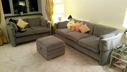 pair of sofas and footstool.