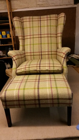 froxfield wing chair and matching stool in moon wool.