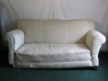 Edwardian triple humped back sofa, with drop arm. in need of total restoration, could have feather seat cushions.