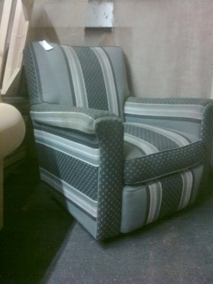 pair of traditionally upholstered arm chairs.