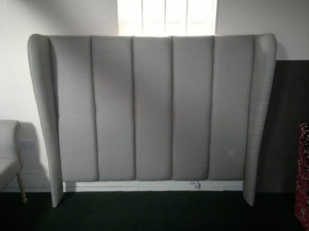 Pannelled winged headboard