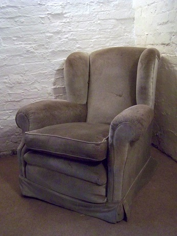 Traditionally upholstered wing armchair for restoration.