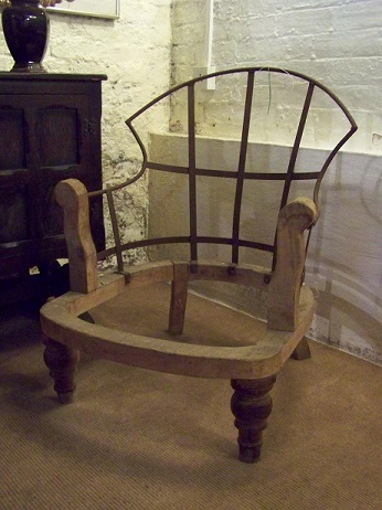 iron framed chair, second picture shows one of the frames upholstered.