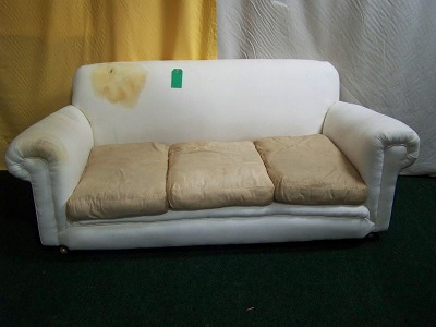 farmhouse sofa, traditionally upholstered would benefit from new feather seat cushions.