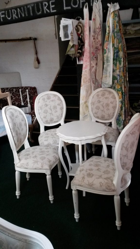 set of four French style dining chairs, covered in floral linen print.