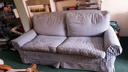 Loose covered sofa for restoration.