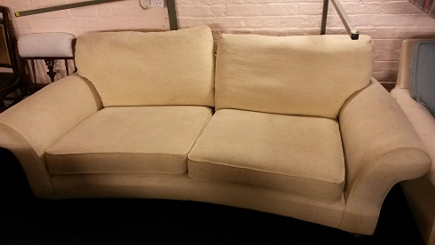 curved sofa for recovering.