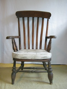 old windsor chair with seat pad.