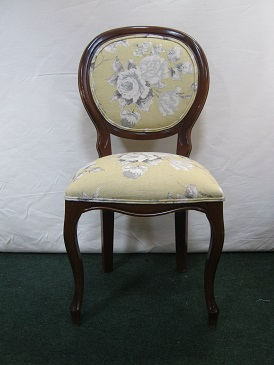 single side chair covered in a floral printed linen.