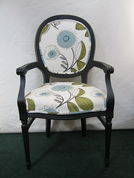 open armed chair covered in a vintage cotton print.