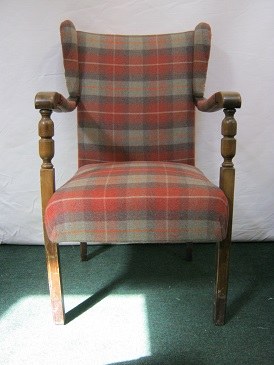 Small winged open armed chair, covered in linwood tartan wool.