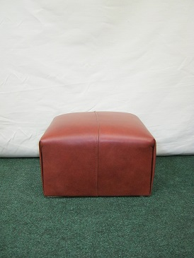 leather pouffe.