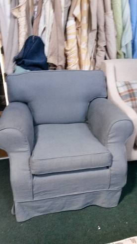 classic arm chair, with slate coloured linen loose cover.